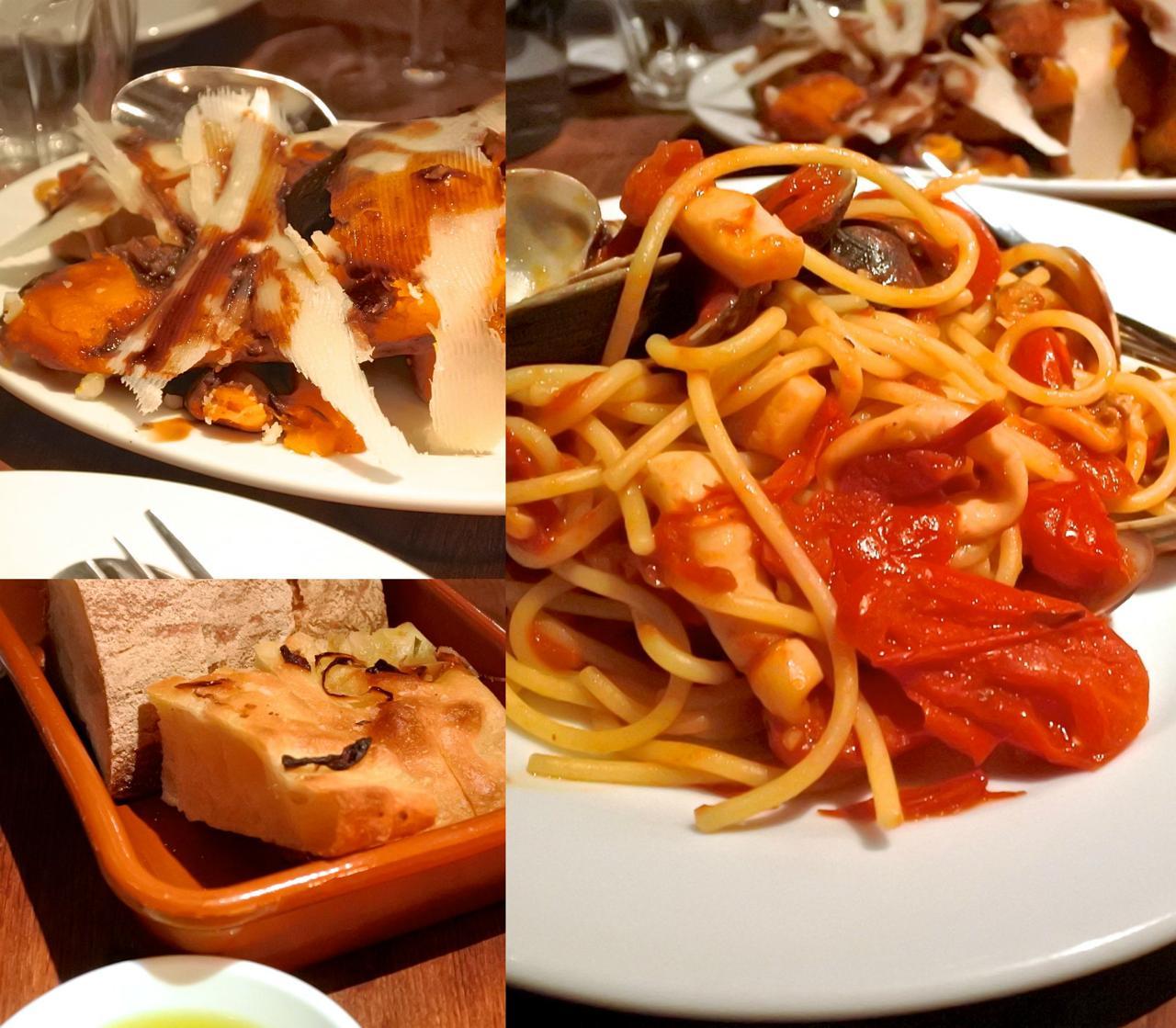 イカとトマトのスパゲッティは基本形(右)。これはアサリをプラスしてもらったもの。左上はカボチャのロースト、セージ風味。旨い!